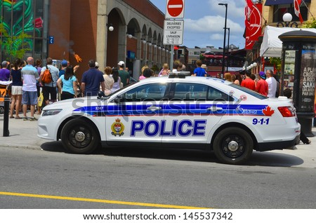 OTTAWA, CANADA, JUNE 30:Car of the Ottawa Police Service (OPS) (Service de police d'Ottawa in French) serves the City of Ottawa, Ontario, Canada. on june 30 2013 in Ottawa Canada. - stock photo