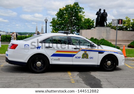 OTTAWA, CANADA, JUNE 30:Car of theThe Royal Canadian Mounted Police RCMP French: Gendarmerie royale du Canada, is both a federal and a national police force of Canada on june 30 2013 in Ottawa Canada. - stock photo