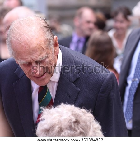OTTAWA, CANADA - JUNE 30, 2010: Prince Philip chats with an admirer during his visit to Ottawa with Queen Elizabeth II.   - stock photo