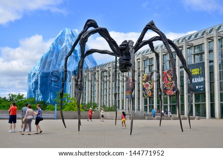 OTTAWA CANADA JUNE 30: Spider sculpture in front the National Gallery of Canada, located in the capital city Ottawa, Ontario, is one of Canada's premier art galleries. On june 30 2013 in Ottawa Canada - stock photo