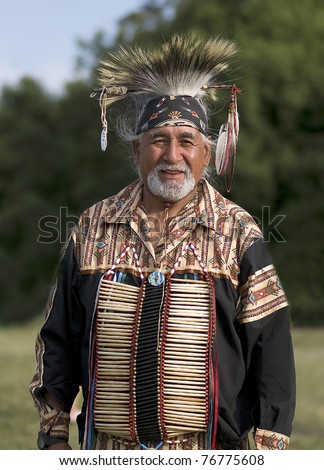 OTTAWA, CANADA - JUNE 16: Unidentified elder indian in full dress during the Powwow festival at Dows lake in Ottawa Canada on  June 16, 2007. - stock photo