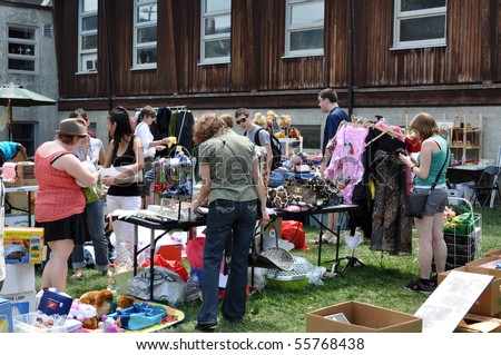 OTTAWA, CANADA - MAY 29: Thousands of people gather at the annual Glebe neighborhood garage sale which takes place for several blocks in the Glebe area of Ottawa, Ontario May 29, 2010. - stock photo