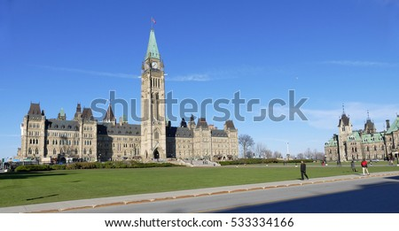 Ottawa, Canada. November 14th 2016 - People relaxing on a sunny day at the Parliament of Canada on Parliament Hill in Ottawa