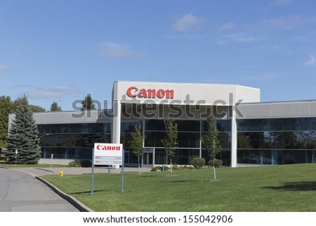 OTTAWA, CANADA - SEPTEMBER 16: A retail outlet for Canon September 16, 2013, Ottawa, Canada. Canon employs over 1,000 across Canada and over 166,000 worldwide. - stock photo