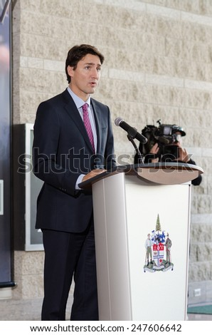 OTTAWA - JANUARY 27: Liberal party leader Justin Trudeau speaks at ceremony commemorating the 70th anniversary of the liberation of Auschwitz in Ottawa on 27 January 2015 at city hall. - stock photo