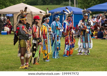 OTTAWA - JUN 21: Teenage boys stand before judges after performing traditional dance in Summer Solstice Aboriginal Arts Festival for Aboriginal Day in Massey Park June 21, 2014 in Ottawa, Canada - stock photo