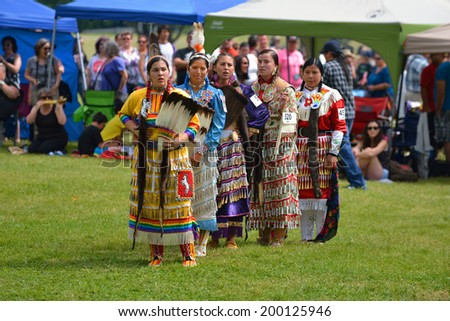 OTTAWA - JUN 21: Teenage girls stand before judges after performing traditional dance in Summer Solstice Aboriginal Arts Festival for Aboriginal Day in Massey Park June 21, 2014 in Ottawa, Canada - stock photo