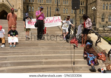 OTTAWA - MAY 22:  People gather for a rally to activate governments to rescue the girls in Nigeria and protect school girls across the world on Parliament Hill during May 22, 2014 in Ottawa, Canada - stock photo