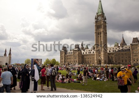 OTTAWA - MAY 9: Pro-life and anti-abortion demonstrators protest in front of the  Parliament buildings in Ottawa on May 9, 2013. - stock photo