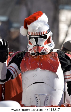 OTTAWA-NOV 17: A storm trooper waves at the crowd from a Star Wars inspired float during the annual Santa Claus Parade  Nov 17, 2007 in Ottawa. - stock photo