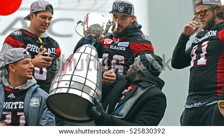 OTTAWA - NOV 29, 2016:  The Ottawa Redblacks enjoy the Grey Cup during Parade at Lansdowne Park.  The team won the city's first CFL championship in 40 years, with an upset over Calgary Stampeders.