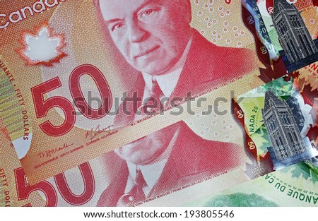 OTTAWA - NOVEMBER 7, 2013:  The Bank of Canada issued new high tech polymer money with holograms that will last longer and be harder to counterfeit. - stock photo