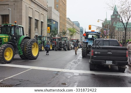 OTTAWA- SEP. 29: Canadian dairy farmers from eastern Ontario park their tractors to Parliament Hill to protest dairy concessions in the Trans-Pacific Partnership in Ottawa, Canada on Sep. 29, 2015.