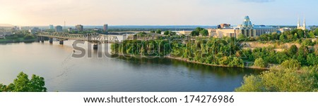 Ottawa sunset panorama over river with historical architecture. - stock photo