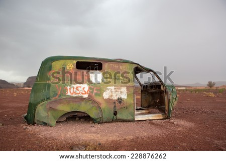 OUARZAZATE, MOROCCO, AUGUST 30: Old vintage and rusted car wreck located on the way to Ouarzazate, Morocco 2014. - stock photo