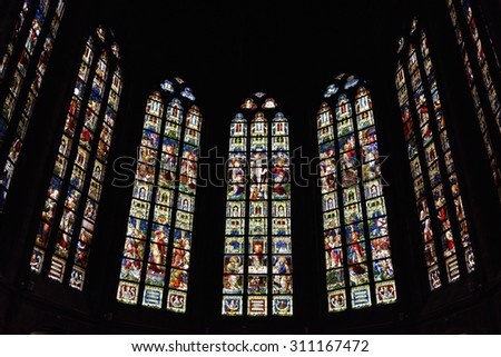 OUDENAARDE, BELGIUM-JUNY 23, 2015: Stained glass window in church Saint Walburga, known from 11 century - stock photo