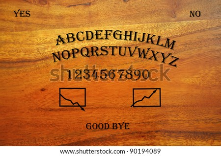 Ouija Board used for stock trading, depicting the unpredictability of the stock market - stock photo