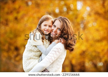 oung mother and her toddler girl have fun - stock photo