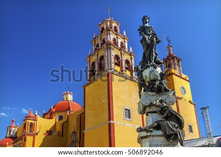 Our Lady of Guanajuato Paz Peace Statue Night Guanajuato, Mexico Statue donated To City by Charles V, Holy Roman Emperor, in the 1500s.  Steeple, Towers, Basilica de Nusetra Senora Guanajuato, Mexico