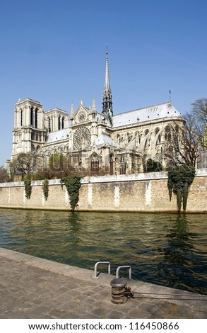 Our Lady of Paris  Notre Dame de Paris  seen from a quay of the Seine  (Paris France) - stock photo