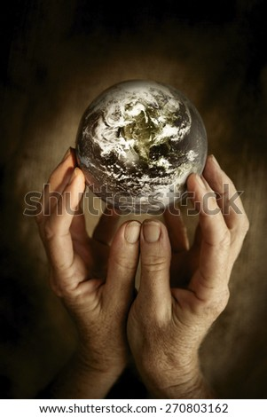 Our World - Some components of this montage are provided courtesy of NASA, and have been found at http://visibleearth.nasa.gov.  - stock photo