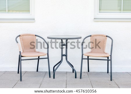 Out door rattans tables and chairs set. - stock photo