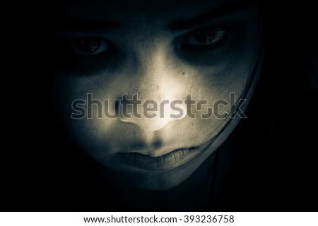 Out from the dark,Portrait of scary girl staring at cameras,Ghost girl hiding from the dark,Horror background for halloween