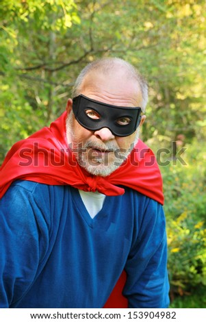Out of breath senior super hero with red cape
