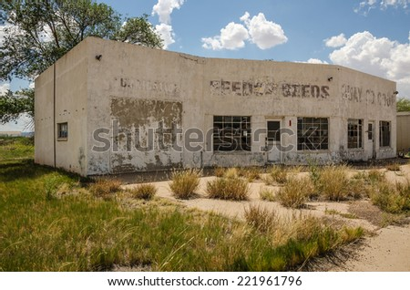 Out of business service station and repair shop looks like it tried other businesses, too, before it closed its doors for good. - stock photo