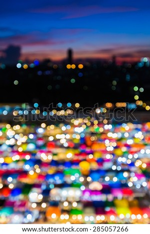 Out of focus, abstract bokeh background of multicolour free market at night  - stock photo