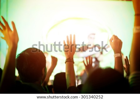 Out of focus crowd of Audience enjoying music in concert on stage - stock photo
