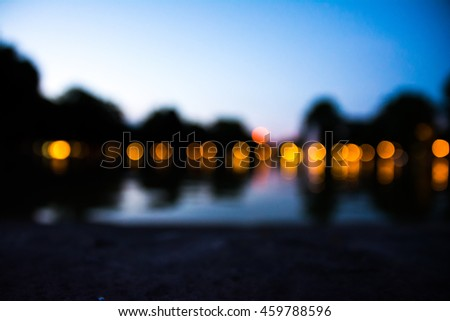 Out of Focus Light Spheres on Water Reflection Outdoors in City
