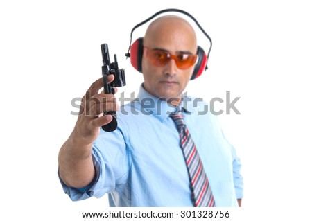 Out of focus man with gun isolated in white - stock photo