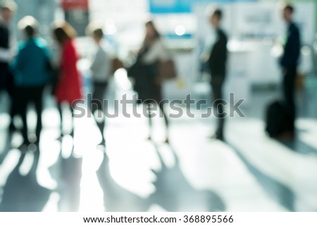 Out of focus shot of people lined up at a generic checkout - stock photo