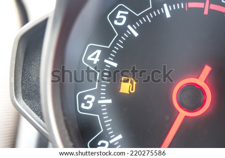 Out Of Gas - A car's gas tank is nearly empty. - stock photo