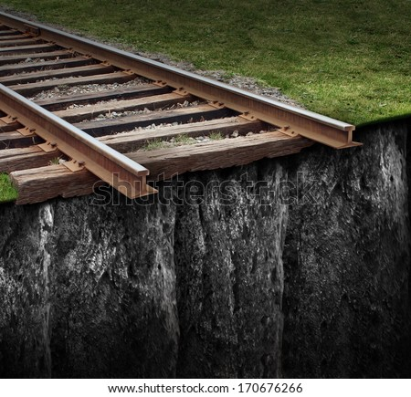 Out of track with a train railway at the edge of a steep cliff as a journey that has been cut abruptly as a closed business concept and metaphor for ending the path due to the lack of support. - stock photo