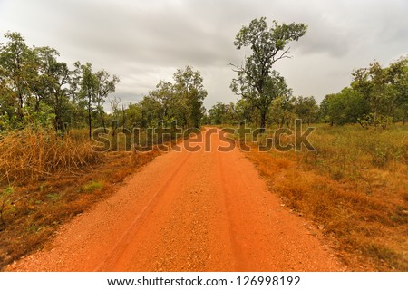 Outback road in the Northern Territory of Australia - stock photo