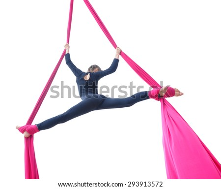 Outdoor activity of cheerful child training on aerial silks or ribbons. Isolated over white background. Childhood, sports, active lifestyle concept. - stock photo