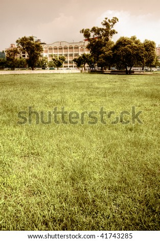 Outdoor apartment and grassland in the park in autumn. - stock photo