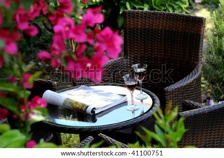 Outdoor aperitif on wooden table - stock photo