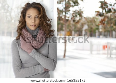 Outdoor autumn photo of attractive young woman.