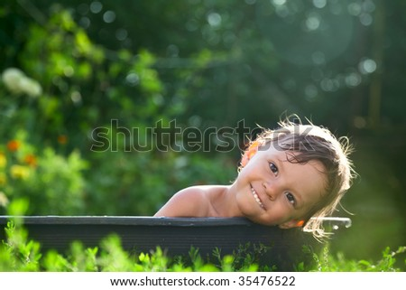 outdoor baby bathing - stock photo