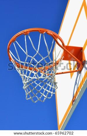 Outdoor basketball hoop against blue sky - stock photo
