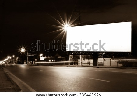 outdoor billboard and light on road in night time ,vintage tone