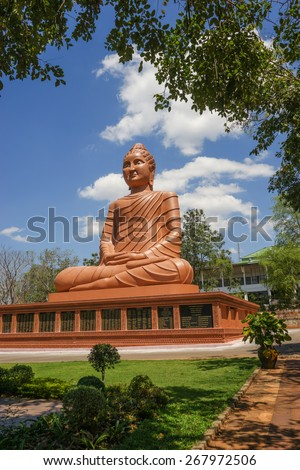 Outdoor Buddha Image in Buddhist temple of Thailand - stock photo