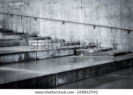 Outdoor building concrete staircases with wet floor - stock photo
