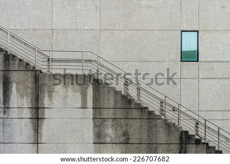 Outdoor building with window and concrete staircases - stock photo