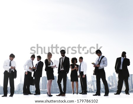 Outdoor Business Meeting on New York City Rooftop - stock photo