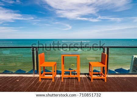 Outdoor cafe chairs with beautiful sea view background