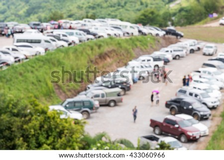 Outdoor car park on the high mountain of the national park with blur focus. - stock photo